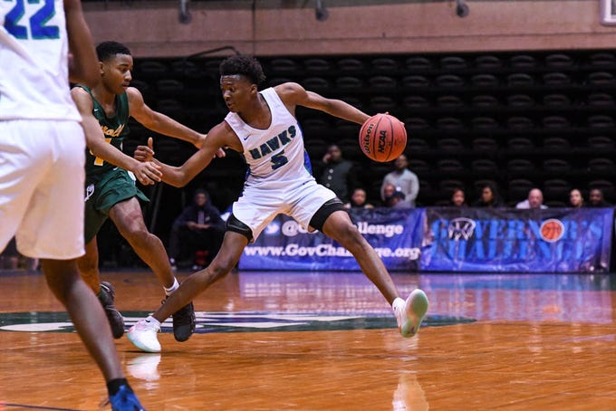 St. Georges' Nah'Shon Hyland (5) moves the ball in a game against Archbishop Carroll during the Governor's Challenge basketball tournament at the Civic Center in Salisbury on Wednesday, Dec 26, 2018.