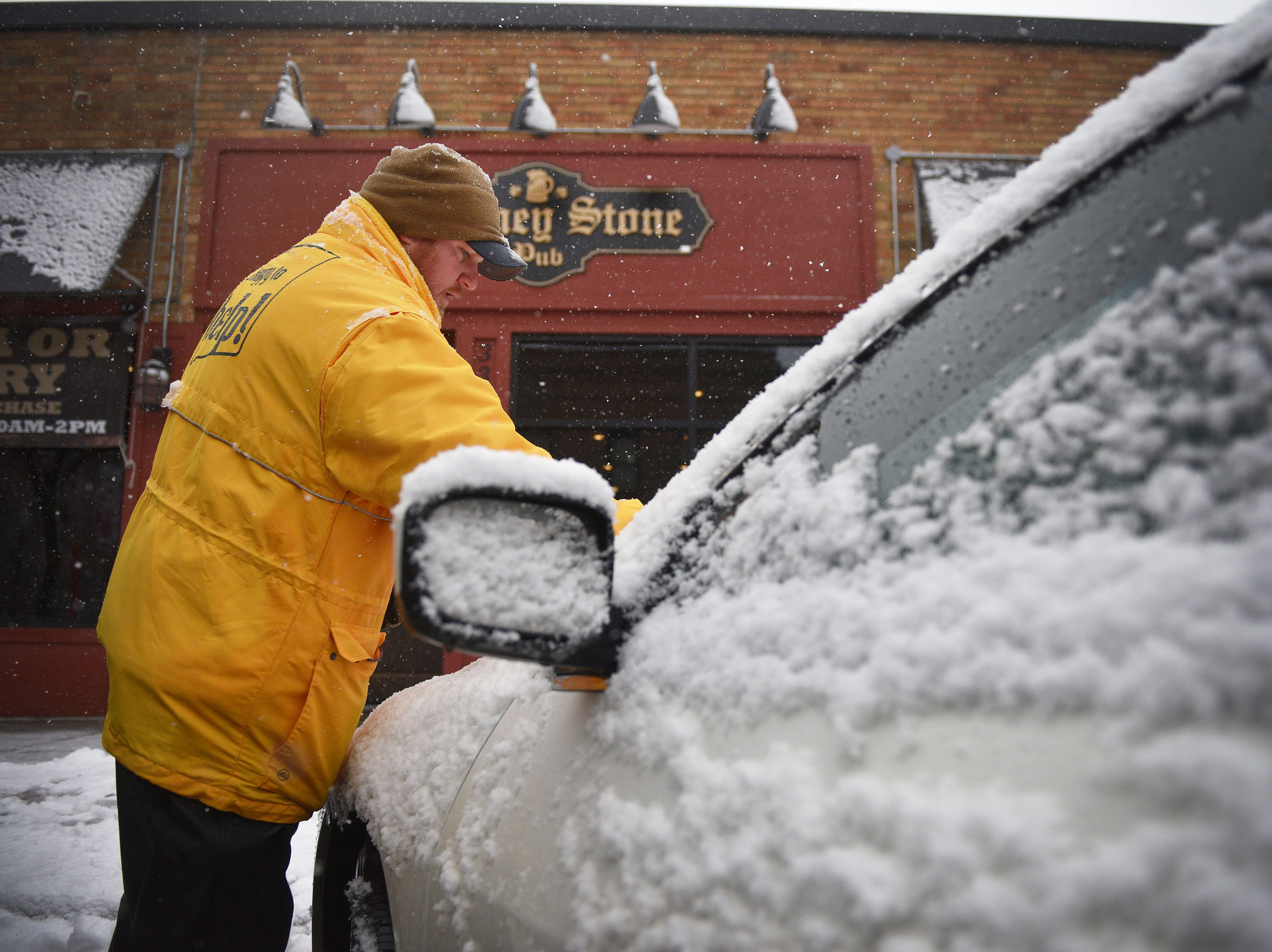 City of Sioux Falls parking patrol Dan Kirstein checks meters Thursday, Dec. 27,  in downtown Sioux Falls. More snow is expected to arrive in South Dakota on Thursday and Friday as a winter storm moves through the area.