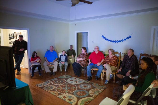 A crowd gathers at the home of Terence and Karen Arenson in Dothan, Ala., who are part of a documentary about struggling Jewish communities around the country.