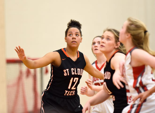 St. Cloud Tech junior Genaya Murray prepares for a rebound Thursday in the Tigers' game with Duluth East at Tech. The Tigers won, 65-59.