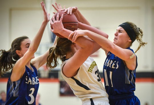 Sartell's Megan Driste (3) and Aubri Akervik (11) team up to guard Anna Caspers of Totino-Grace during the St. Cloud Tech Girls' Basketball Holiday Classic Thursday, Dec. 27, in St. Cloud.