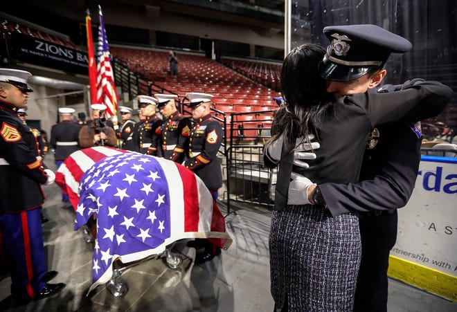 Elizabeth Romrell embraces a South Salt Lake police officer after the funeral for her husband, South Salt Lake Police Officer David Romrell, at the Maverik Center in West Valley City on Dec. 5, 2018. David Romrell was one of two Utah law-enforcement officers who died in the line of duty in 2018.