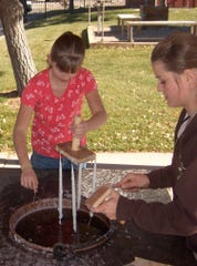 Candle dipping is one of many traditional crafts taught at Frontier Homestead State Park. The Homestead welcomes Iron County students to take part in a new program in 2019.