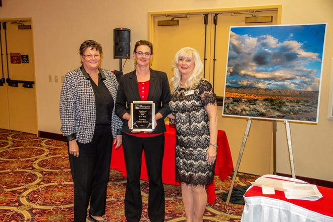 Eureka Casino Resort's Alisha Rossell is joined by Mesquite Chamber of Commerce CEO Carol Kolson in receiving the 2018 Mesquite Chamber of Commerce Member of the Year award.