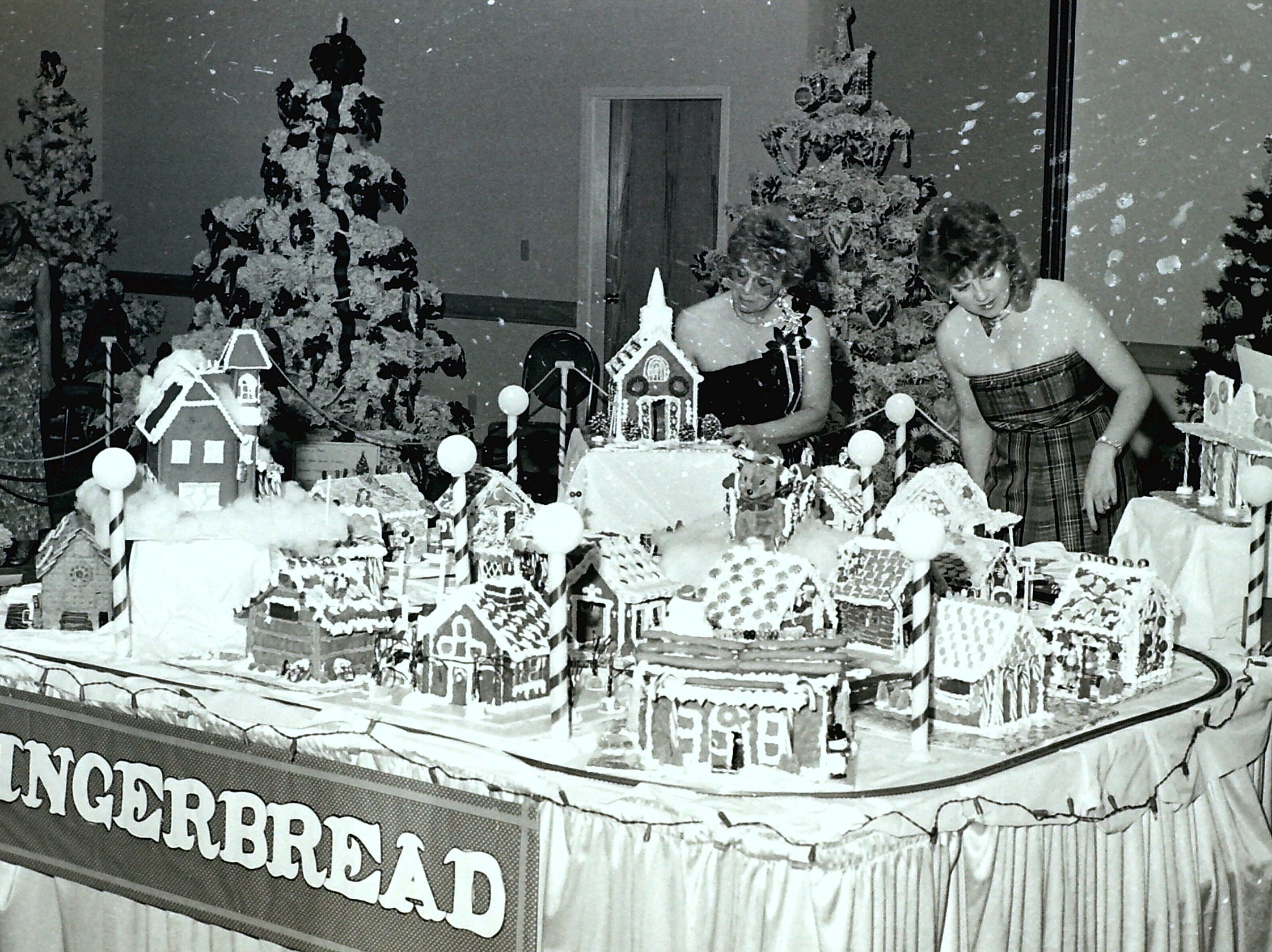 Attendees look over the gingerbread house submissions at the Jubilee of Trees circa 1985.