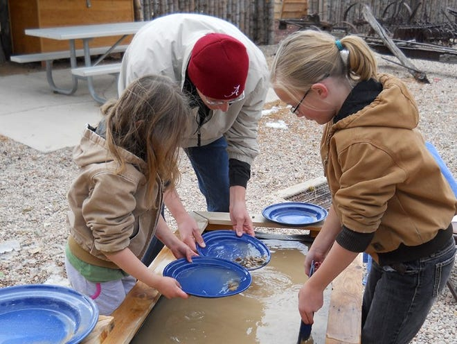 Visitors take a turn panning for gold at Frontier Homestead State Park. The Homestead takes part in Wonder Wednesdays, a program for Iron County students.