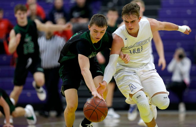Amherst's Carson Sneller, right, and Almond-Bancroft's Zach Bunders chase down a loose ball during the 47th annual Sentry Classic on Thursday at Quandt Fieldhouse in Stevens Point.