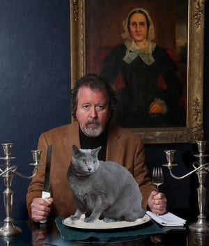 Columnist Mark Hinson and Russian Blue cat Pinko. He is well known for his cat columns.