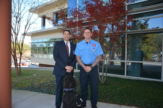 Purple Heart recipient, Jack Capra, Executive Officer and General Counsel for Northwest Florida State College with his service dog, 7 year old Labradoodle Rocco and Purple Heart Recipient Erick Torres