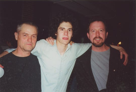 Film director Jonathan Demme, left, artist Jimmy Joe Roche, center, and columnist Mark Hinson at Sail High School.