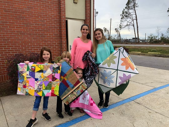 This family of eight, three of whom are not pictured, receives quilts. Their home was damaged by Hurricane Michael and they are temporarily living in a 2-bedroom, 1-bath home.