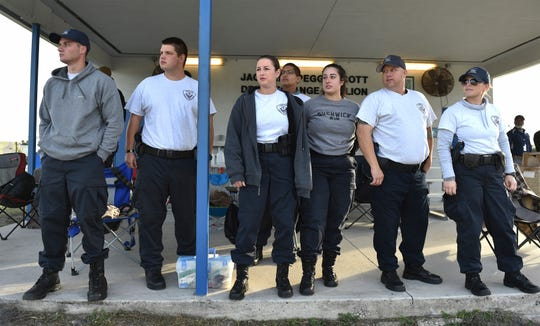 "Law Enforcement Academy Track students Mike Dacey (from left), Matt Reeder, Alexis Valus, Daniel Herrera, Alexandra Eksioglu, Daniel Hoffman, and Nina Popovich watch their fellow students train on slide recovery in police cruisers on a wet roadway on Thursday, Nov. 29, 2018, at the Treasure Coast Public Safety Training Complex in Fort Pierce. ""The instructors are great,"" Valus said. ""They're very patient. They know how to work with you. They can identify what you have an issue with and identify it immediately."""