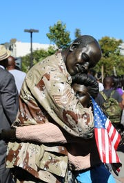 """Coming Home"" is one of Seward Johnson's sculptures from his ""Celebrating the Familiar"" series."
