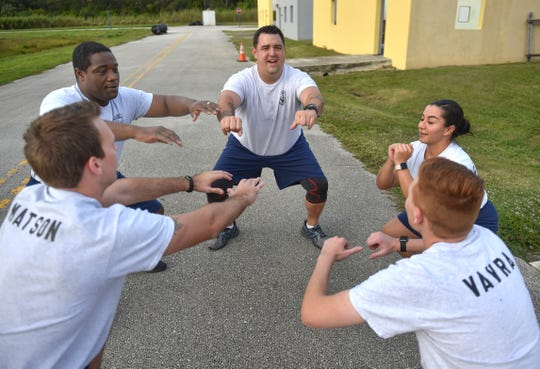 "Law Enforcement Academy Track program students, (clockwise from left) Zachary Matson, Michel Jean, Dennis McKenzie, Daniela Deantonio, and Tyler Vavra, exercise as part of their training on Thursday, Nov. 29, 2018, at the Treasure Coast Public Safety Training Complex in Fort Pierce. ""It gives me a lot of pride to take part in training to basically pursue an honorable career,"" McKenzie said."