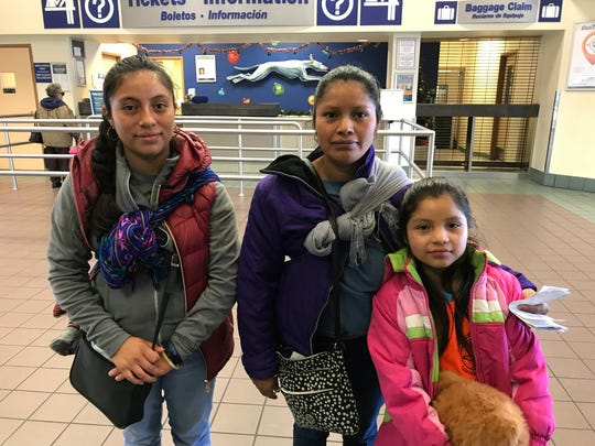 Estela Tomas Felipe, who carried a 1-year-old in a sling, and Maria Miguel Tomas, with her 8-year-old daughter, Juana Marisol, waited at the Greyound bus station in Downtown El Paso on Dec. 27, 2018. They were among the more than 1,500 immigrants released in El Paso this week.