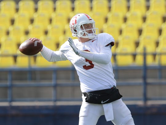 Stanford quarterback K.J. Costello warms up before the team's practice Thursday at Eastwood High School as the Cardinal prepare for their Hyundai Sun Bowl appearance against Pitt.