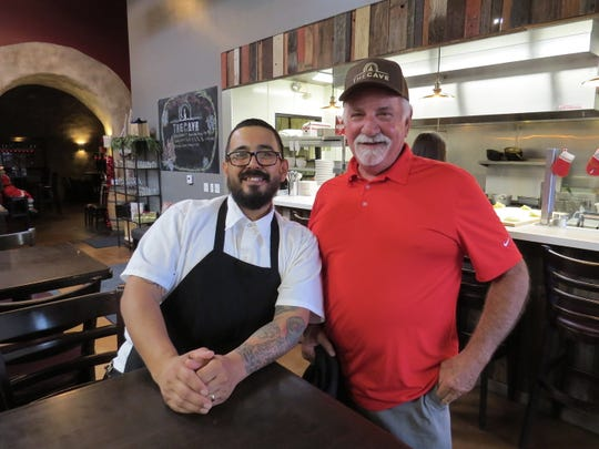 Henry Martinez, left, the new executive chef at The Cave, poses with Nick Fisher, the business' founder. The wine bar is located inside the Ventura Wine Co.