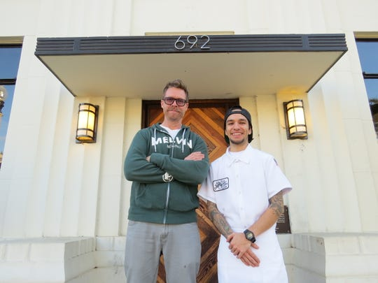 "Aaron Duncan, left, chef and co-owner of Fluid State Beer Garden in Ventura, poses with the restaurant's new executive chef, Alexander Montoya. Although additions to the menu are planned, fans of Fluid State's popular pizzas have nothing to fear. ""Some of the pizzas have a following. I respect that. I don't intend to mess with people by changing them,"" Duncan says."
