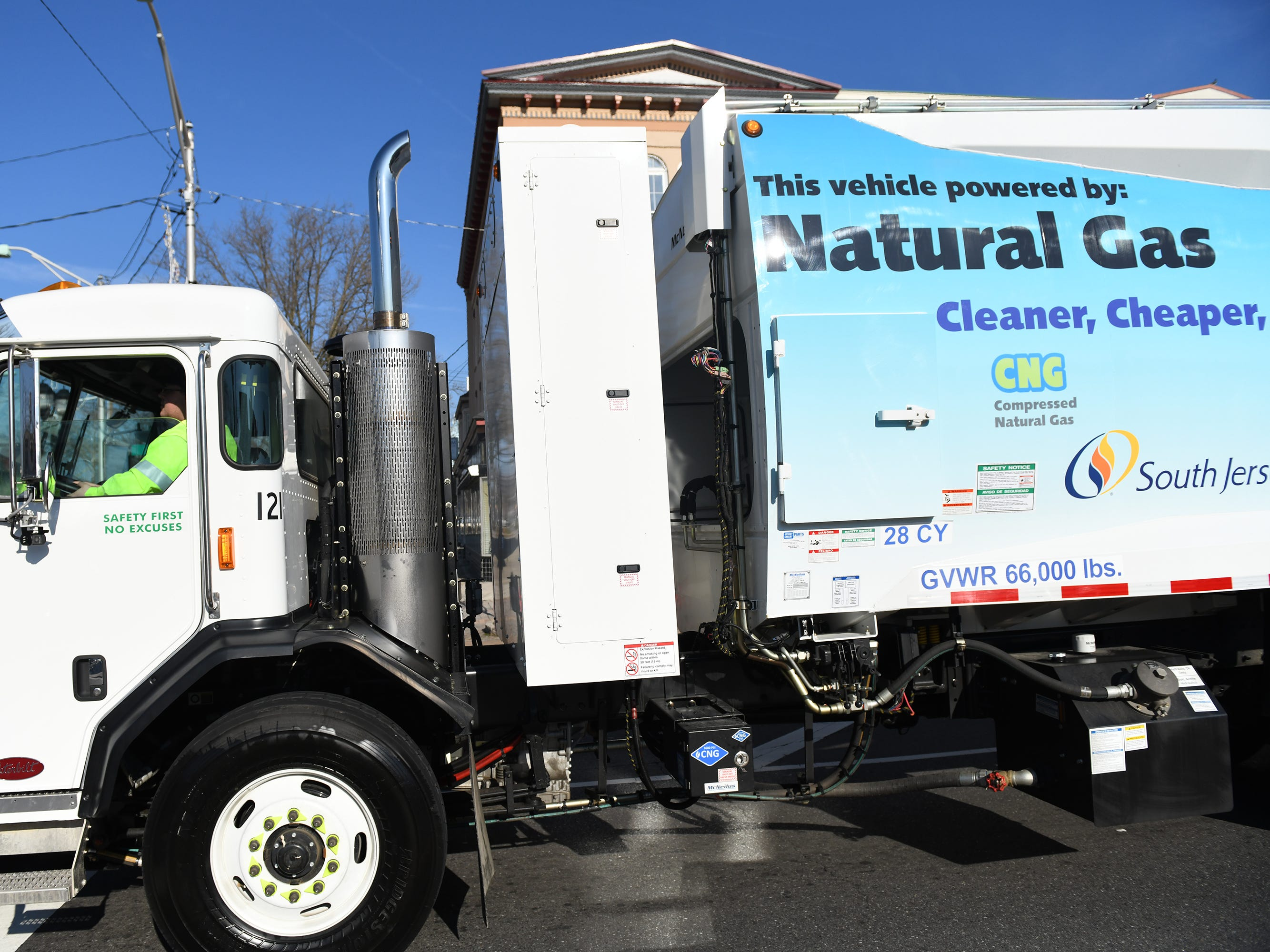 A fleet of 11 new compressed natural gas collection vehicles travels along Landis Avenue in Vineland on Thursday, December 27, 2018.  The Atlantic County Utilities Authority drove the vehicles through the city of Vineland to kick off their partnership with the Cumberland County Improvement Authority and the City of Vineland.