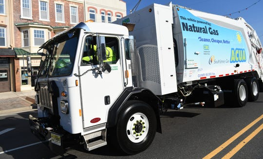 The Atlantic County Utilities Authority operates trash collection vehicles like this one.