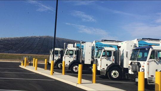 A new trash collection fleet from the Atlantic County Utilities Authority lined up Thursday morning at the its new base, the Cumberland County Improvement Authority in Deerfield Township. A covered portion of the CCIA landfill and its resident sea gulls are in the background.
