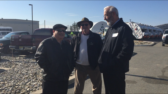Vineland City Council President Paul Spinelli (left), Vineland Public Works Director Mark Guglielmi (center), and Atlantic County Utilities President Richard S. Dovey chat on Thursday after the arrival of a fleet of ACUA trash collection vehicles. The fleet goes to work Jan. 2, 2019 in Vineland.