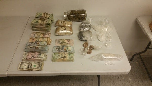 Detectives seized roughly five pounds of heroin, one pound of methamphetamine, a quarter pound of cocaine and $45,123 in cash.