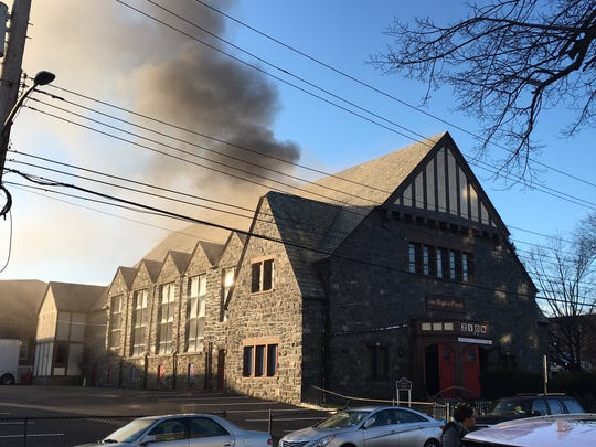 Smoke billows out of the Zion Baptist Church on Lockwood Avenue in New Rochelle on Thursday, Dec. 27, 2018.