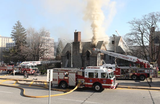 Smoke billows from the roof as New Rochelle firefighters and mutual aid firefighters battle a three alarm fire at the Zion Evangelical Baptist Church on Lockwood Avenue in New Rochelle, Dec. 27, 2018.
