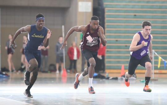 Our Lady of Lourdes' Jaheim Jones, left, Albertus Magnus' Lavonno Mitchel and Clarkstown North's Josh Harmsen are off the blocks in the 55-meter dash during the Pearl River Holiday Track & Field Festival held at Rockland Community College in Suffern on Thursday, December 27, 2018.