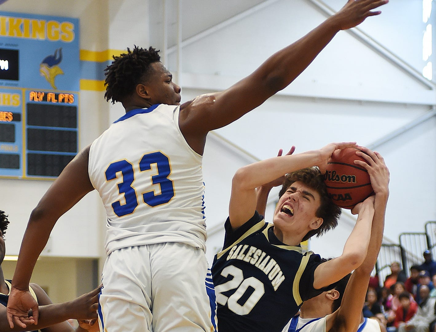 Sallies #20 Justin Molen fights for the ball past CR's Kamal Marvel and William Burke as Slam Dunk to the Beach kicked off on Thursday December 27th with the opening game of Caesar Rodney playing Salesianum at the tournament held at Cape Henlopen High School.