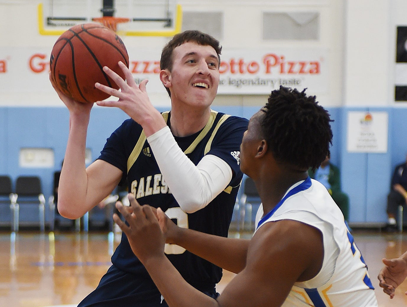 Sallies #10 Jack Brown moves the ball for a basket over CR's #33 William Burke as Slam Dunk to the Beach kicked off on Thursday December 27th with the opening game of Caesar Rodney playing Salesianum at the tournament held at Cape Henlopen High School.