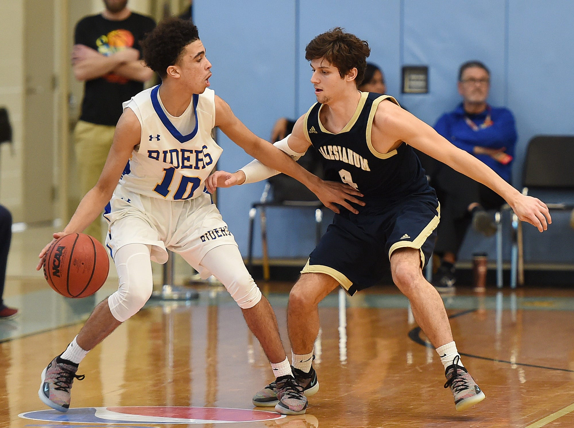 CR's #10 Kamal Marvel moves the ball past Sallies #4 Max Ferrante as Slam Dunk to the Beach kicked off on Thursday December 27th with the opening game of Caesar Rodney playing Salesianum at the tournament held at Cape Henlopen High School.