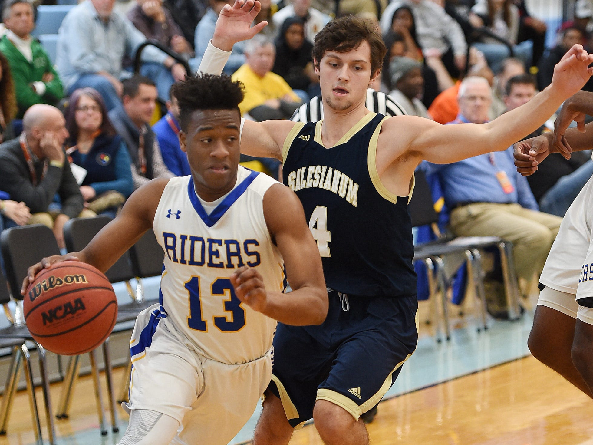 CR's #13 Zayquan Eaton goes for a basket past Sallies #4 Max Ferrante as Slam Dunk to the Beach kicked off on Thursday December 27th with the opening game of Caesar Rodney playing Salesianum at the tournament held at Cape Henlopen High School.