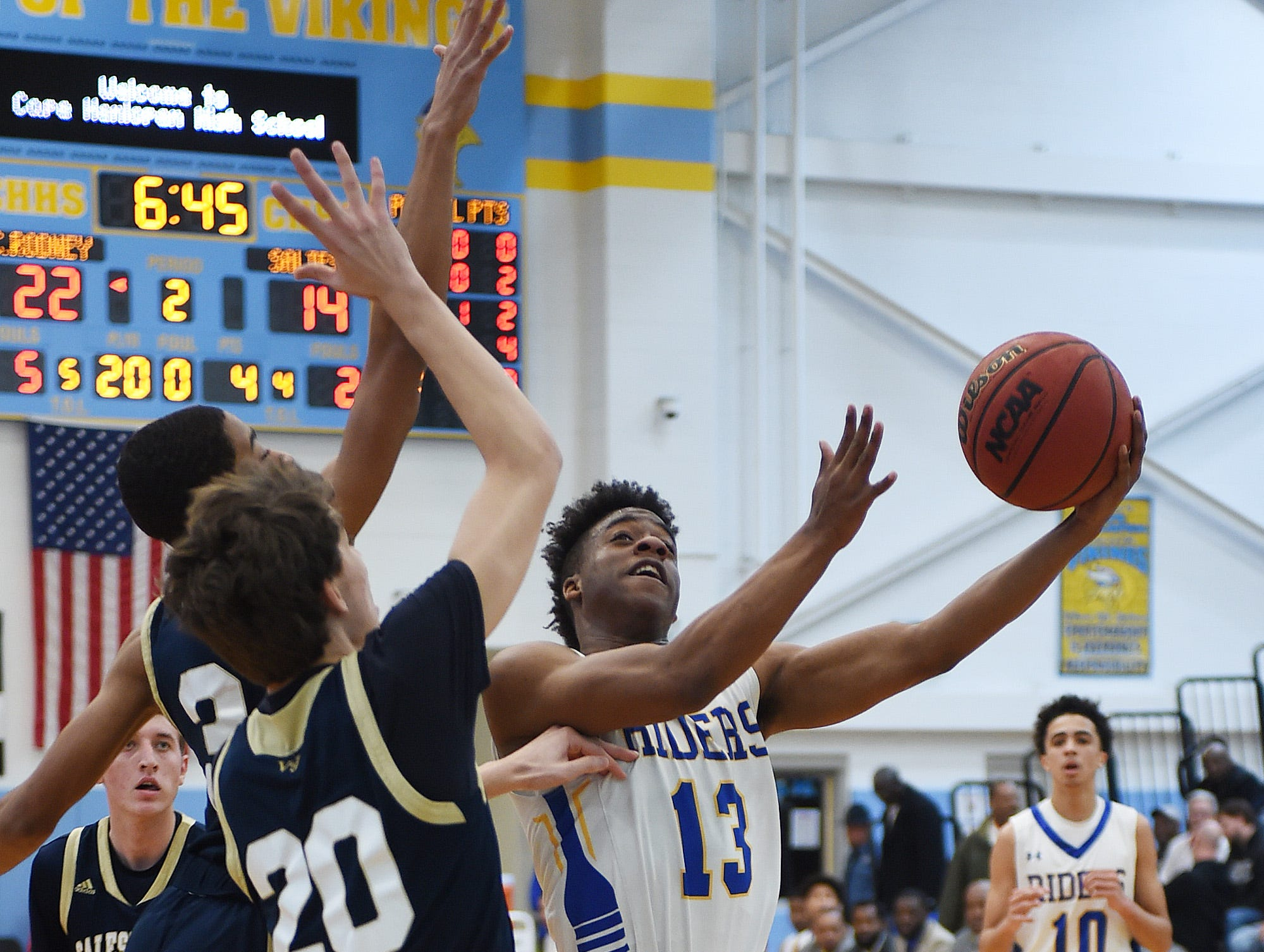 CR's #13 Zayquan Eaton goes for a basket as Slam Dunk to the Beach kicked off on Thursday December 27th with the opening game of Caesar Rodney playing Salesianum at the tournament held at Cape Henlopen High School.