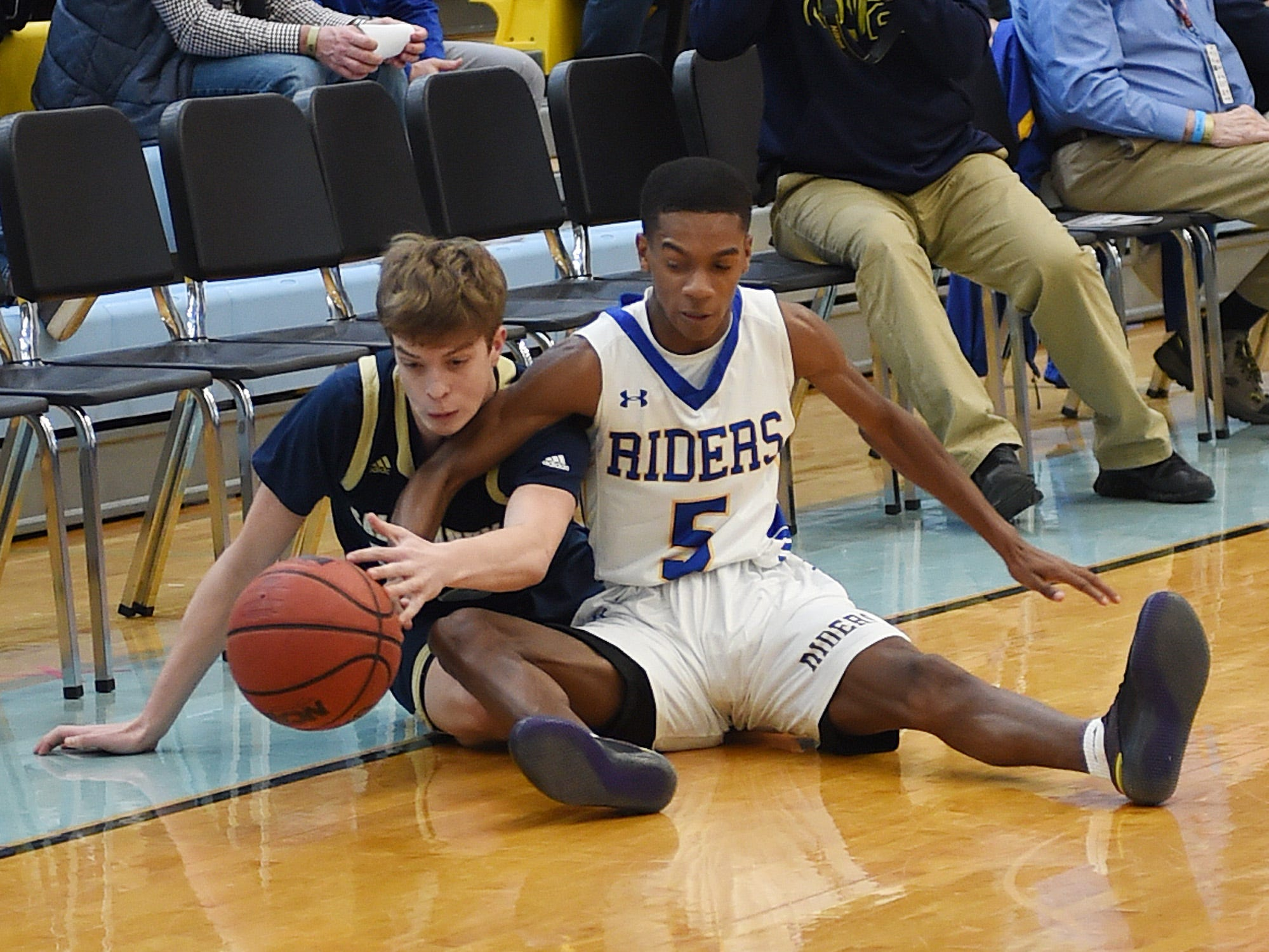 CR's #5 Jaden Corbett and Sallie's #32 Thomas Montooth fight for the ball as Slam Dunk to the Beach kicked off on Thursday December 27th with the opening game of Caesar Rodney playing Salesianum at the tournament held at Cape Henlopen High School.