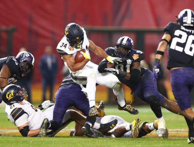 TCU's L.J. Collier (91) makes the tackle on California running back Christopher Brown Jr. (34) Wednesday at the Cheez-It Bowl.