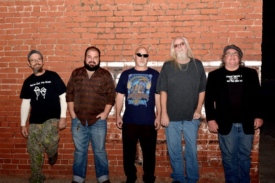 Members of the Tuna Blues band are shown from left to right, Barry Sloan, Jimi Divine, Joe Splawn, Jason Brown and Paul Carr. Divine died suddenly early Wednesday morning.