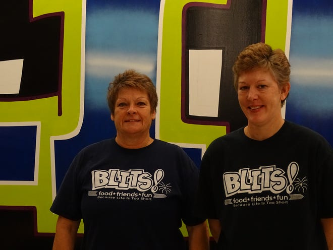 Joy Erb (left) and Wendi Roberts have operated Blits, a combination restaurant-arcade, in Zanesville for ten years.