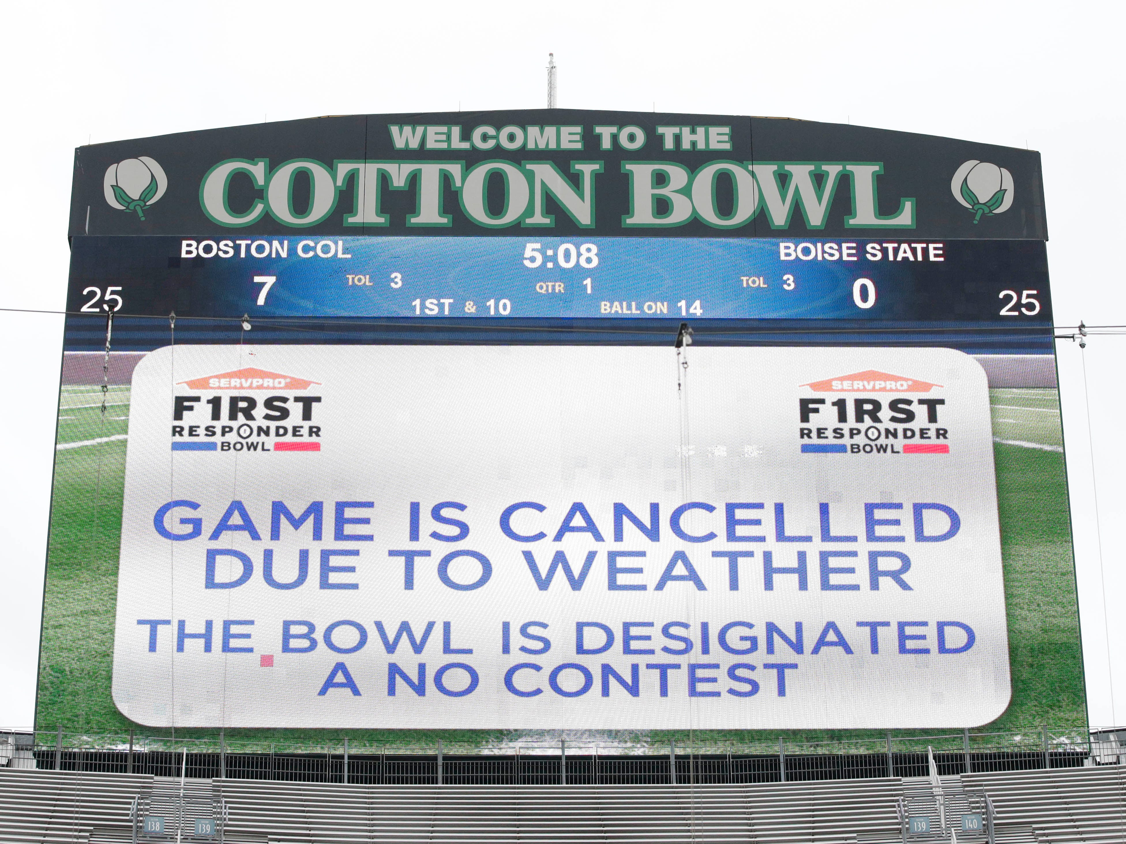 The scoreboard shows that the First Responder Bowl at the Cotton Bowl between Boston College and Boise State  was canceled.