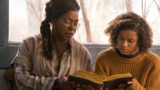 "Gugu Mbatha-Raw (right) stars as a woman with superpowers who reconnects with her mom (Lorraine Toussaint) while on the run in the thriller ""Fast Color."""