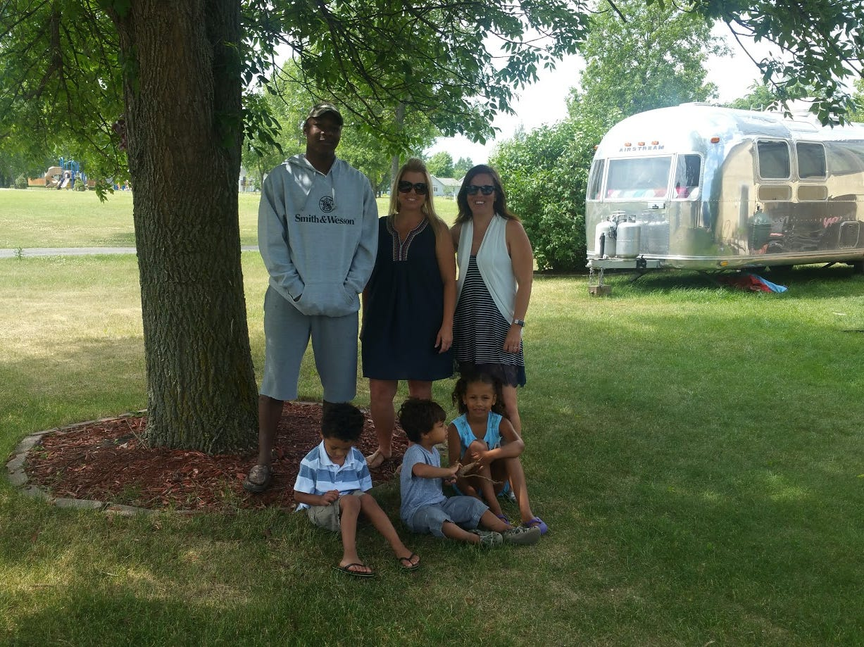 (From left to right) Dion Cox, Misty Latham, and Carly Cox of North Dakota behind Eli Cox, Reggie Latham, and Nya Cox. The Cox family owns a 1976 Airstream.