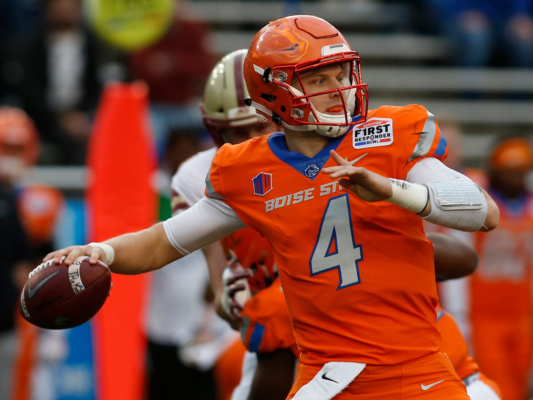 Boise State quarterback Brett Rypien  throws a pass in the first quarter against Boston College in the First Responder Bowl at the Cotton Bowl. The game was canceled due to weather.