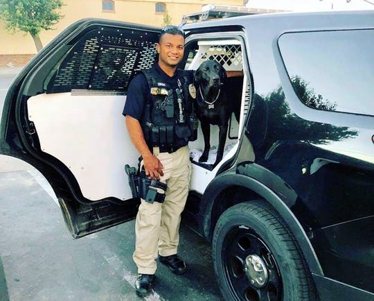 """This undated photo provided by the Newman Police Department shows officer Ronil Singh of Newman Police Department. The Stanislaus County Sheriff's Department said Singh was conducting a traffic stop early Wednesday when he called out """"shots fired"""" over his radio."""