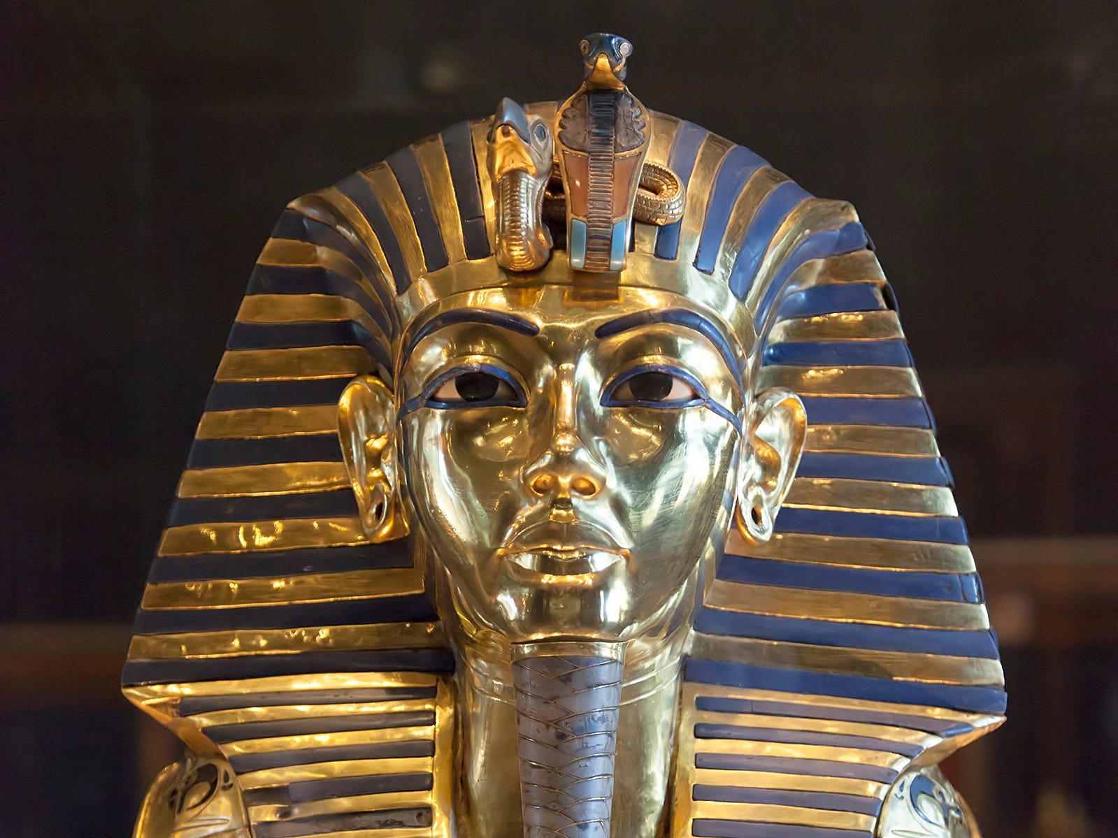 Cairo's Grand Egyptian Museum will be one of the largest museums in the world, displaying artifacts like the funerary mask of King Tutankhamun.