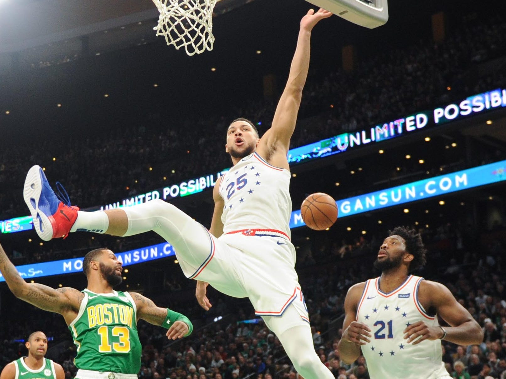 Dec. 25: Sixers guard Ben Simmons (25) loses control of the ball on a drive to the basket during the first half against the Celtics in Boston.