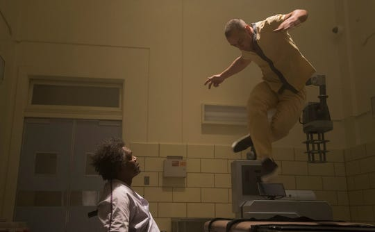 """Mr. Glass (Samuel L. Jackson, left) is fascinated by the multiple personalities of fellow supervillain inmate Kevin Crumb (James McAvoy) in M. Night Shyamalan's """"Glass."""""""