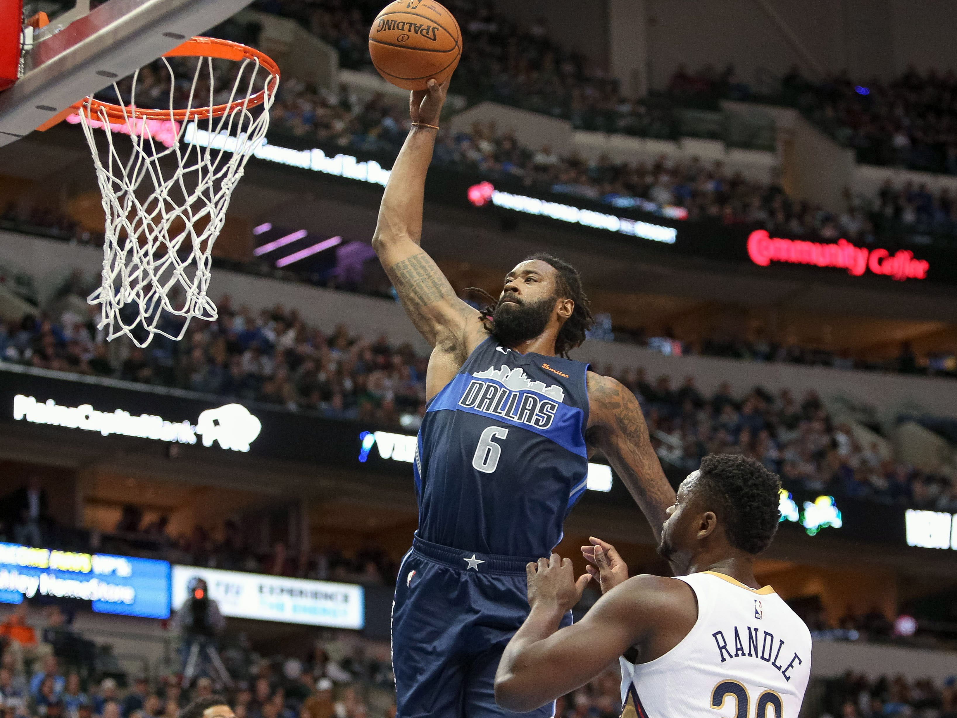 Dec. 26: Mavericks center DeAndre Jordan soars to the hoop for a monster one-handed slam during the first half against the Pelicans.