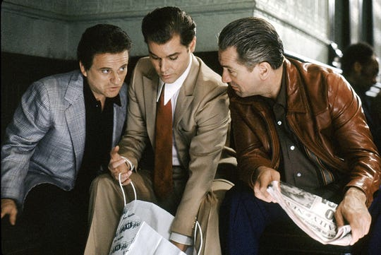 """(L-R) Joe Pesci as Tommy DeVito, Ray Liotta as Henry Hill and Robert De Niro as James Conway in a scene from """"Goodfellas."""""""
