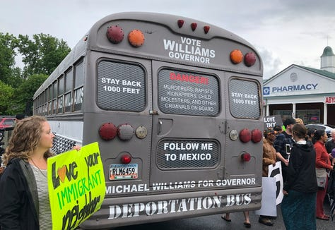 "State Sen. Michael Williams' ""Deportation Bus,"" in which he traveled the state in his gubernatorial campaign, is  surrounded by protesters in Clarkston, Georgia."